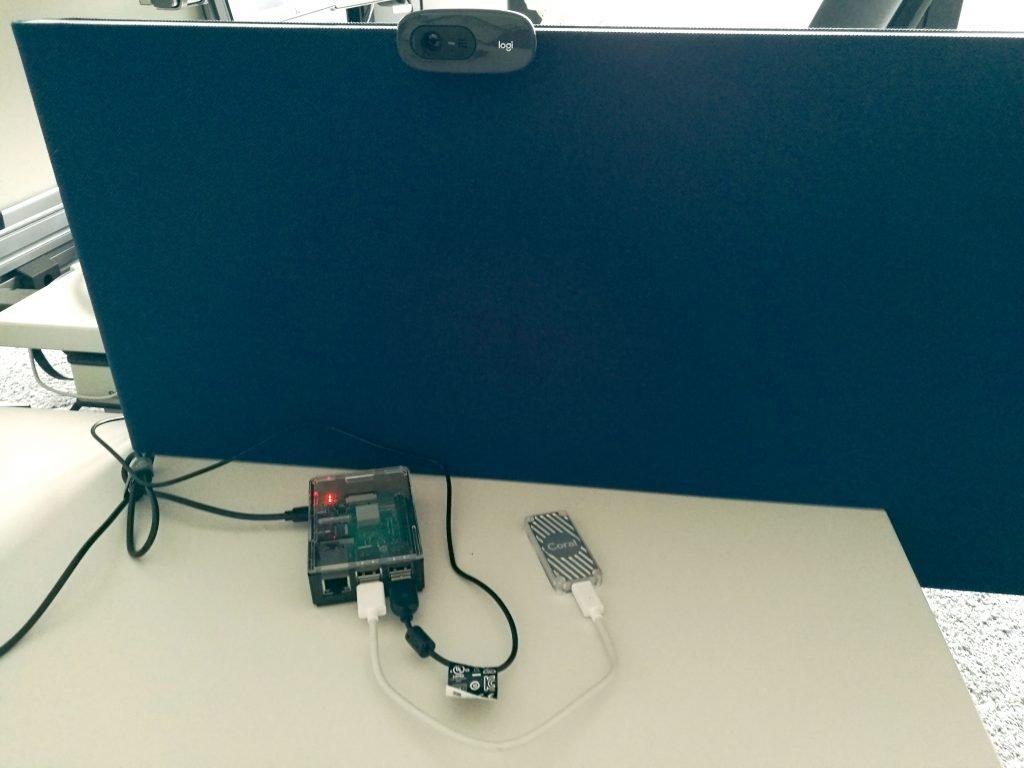Shows the setup (Raspberry pi + Webcam + Coral TPU)
