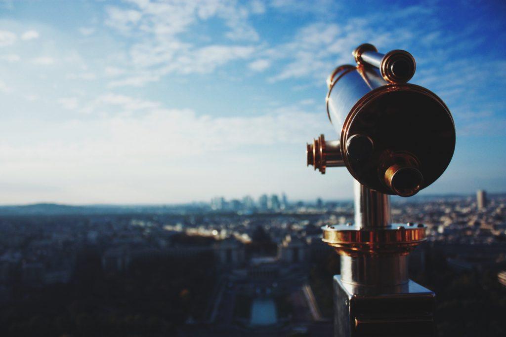 telescope over cityscape