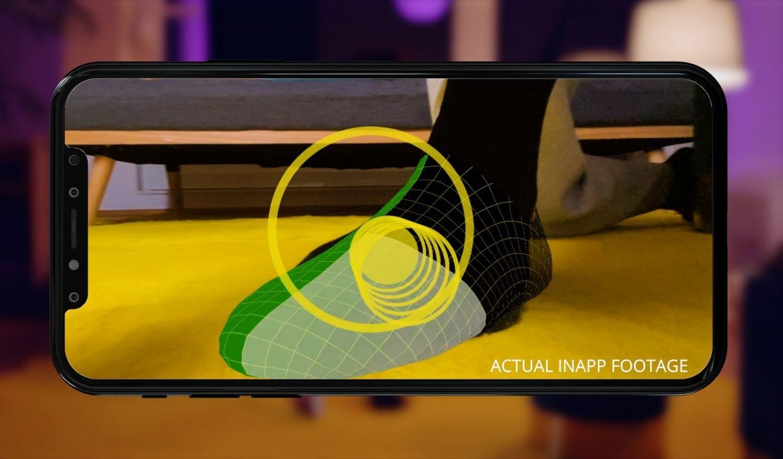 Ein Fuß wird mit der Spotsize-App gescannt